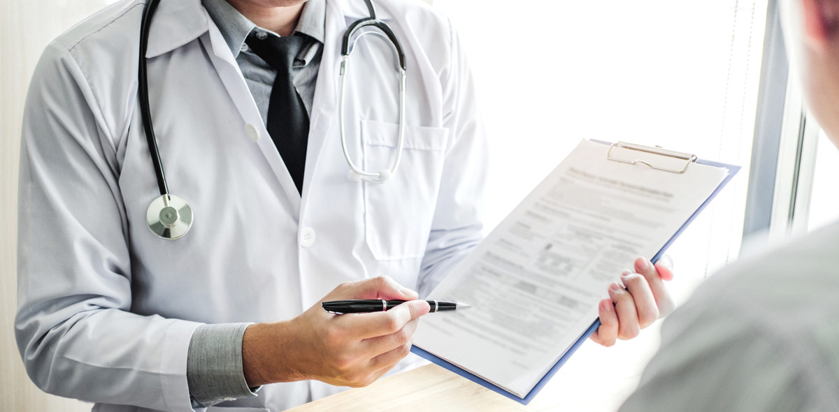 doctor holding a clipboard.